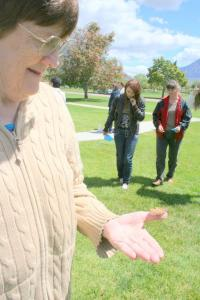 woman releasing a live butterfly