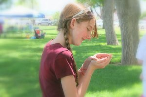girl enjoys releasing a butterfly